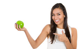 Happy smiling woman pointing at an apple Stock Image
