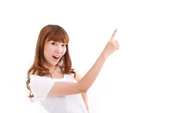 Happy, smiling woman pointing at blank space Stock Photography