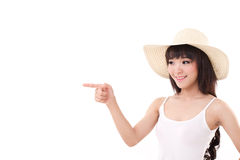 Happy, smiling woman pointing finger away Royalty Free Stock Photography