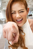 Happy, smiling woman pointing finger at you Royalty Free Stock Images