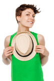 Happy smiling woman posing with a hat Royalty Free Stock Photography