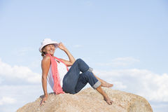 Happy smiling woman posing on top of mountain Royalty Free Stock Photography