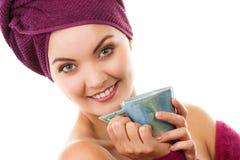 Happy smiling woman in purple bathrobe, enjoying freshness and wellbeing Stock Photo
