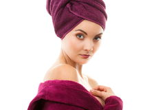 Happy smiling woman in purple bathrobe, enjoying freshness and wellbeing Royalty Free Stock Image