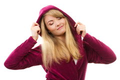 Happy smiling woman in purple bathrobe with hood, enjoying freshness and wellbeing Royalty Free Stock Images