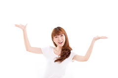 Happy, smiling woman raising her both hands, showing something. On blank space stock photography