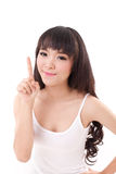 Happy, smiling woman raising, pointing her finger up Stock Images