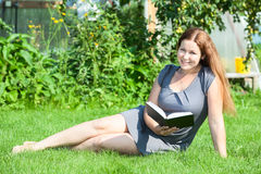 Happy smiling woman reading book stock photos