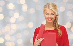 Happy smiling woman in red dress with gift box Royalty Free Stock Photos