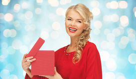 Happy smiling woman in red dress with gift box Royalty Free Stock Image