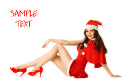 Happy smiling woman in red xmas costume Stock Images