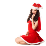 Happy smiling woman in red xmas sexy costume Royalty Free Stock Images