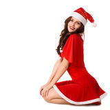 Happy smiling woman in red xmas costume. Isolated stock photos