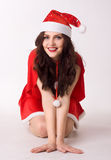 Happy smiling woman in red xmas sexy costume Royalty Free Stock Image