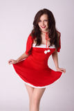 Happy smiling woman in red xmas sexy costume Royalty Free Stock Photo