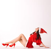 Happy smiling woman in red xmas sexy costume lie Stock Photos