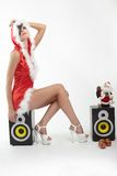 Happy smiling woman in red xmas costume on wh Royalty Free Stock Photos