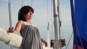Happy smiling woman relaxing on sailboat, traveling, cruise. Stock footage stock video