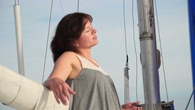 Happy smiling woman relaxing on sailing yacht, meditation. Stock footage stock video footage
