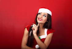 Happy smiling woman in santa claus christmas costume looking up Stock Photography