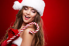 Happy smiling woman in santa claus christmas costume Stock Images