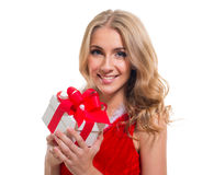 Happy smiling woman in santa claus clothes with present box Royalty Free Stock Photography