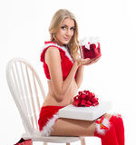 Happy smiling woman in santa claus clothes with present box Stock Images