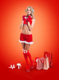 Happy smiling woman in santa claus clothes. Royalty Free Stock Photo
