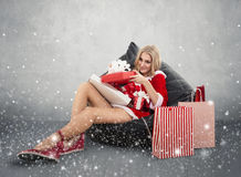 Happy smiling woman in santa claus clothes. Stock Photo