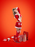 Happy smiling woman in santa claus clothes. Royalty Free Stock Images