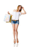 Happy smiling woman with shopping bags isolated Royalty Free Stock Photos