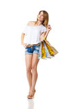 Happy smiling woman with shopping bags isolated Royalty Free Stock Image