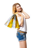 Happy smiling woman with shopping bags isolated Royalty Free Stock Photography
