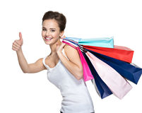 Happy smiling woman with shopping bags  with thumb up Stock Photography