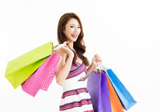 Happy smiling woman with shopping bags. Young happy smiling woman with shopping bags royalty free stock photo