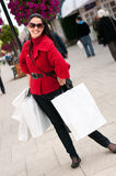 Happy smiling woman shopping with white bags Royalty Free Stock Image