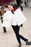 Happy smiling woman shopping with white bags Stock Image