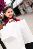 Happy smiling woman shopping with white bags Stock Photography