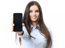 Happy smiling woman showing mobile phone isolated in white Royalty Free Stock Photography