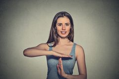 Happy, smiling woman showing time out gesture with hands Stock Photo