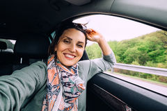 Happy smiling woman sits in auto Royalty Free Stock Photo