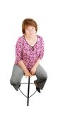Happy smiling  woman sitting on a bar chair . Royalty Free Stock Images