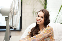 Happy and smiling woman sitting near ventilator Royalty Free Stock Photo