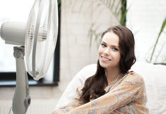 Happy and smiling woman sitting near ventilator Stock Image