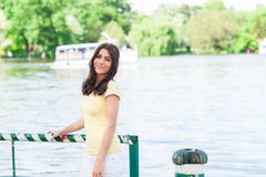 Happy smiling woman sitting in the park by lake Royalty Free Stock Photos