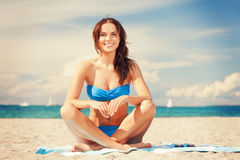Happy smiling woman sitting on a towel. Picture of happy smiling woman sitting on a towel Stock Photos
