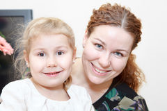Happy smiling woman with small child Royalty Free Stock Photo