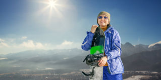 Happy smiling woman with snowboard on the mountain hill Royalty Free Stock Images