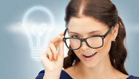 Happy and smiling woman in specs. Bright picture of happy and smiling woman in specs Stock Photos