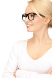 Happy and smiling woman in specs. Picture of happy and smiling woman in specs Stock Photography